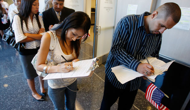 Recently naturalized U.S. citizens register to vote in Las Vegas, Nevada, in August 2008.