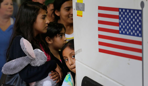Immigrants from El Salvador and Guatemala board a bus in San Antonio on July 7, 2015.