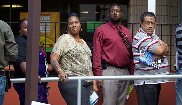 People wait to vote early, October 28, 2012, in Miami.