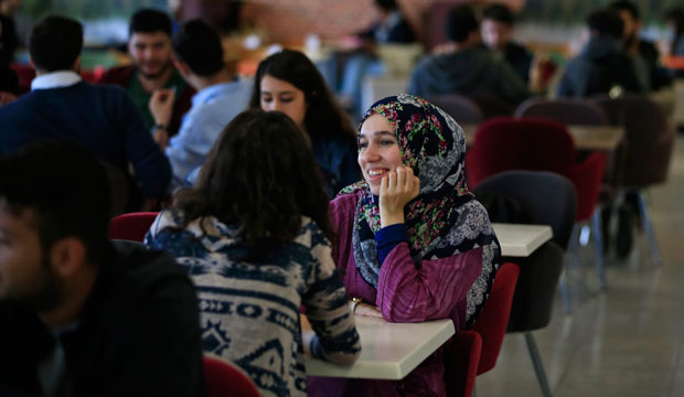 Students sit in the cafeteria of Fatih University in Istanbul, Turkey, October 2, 2015.