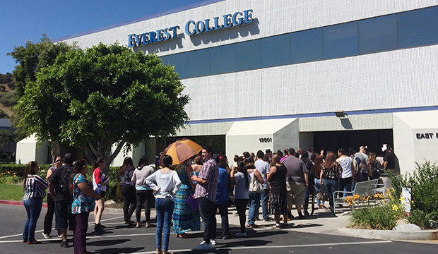 Students wait outside Everest College in Industry, California, hoping to get their transcriptions and information on loan forgiveness and transferring credits to other schools, April 28, 2015, following the collapse of Corinthian Colleges.