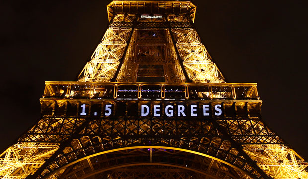 "The slogan ""1.5 degrees"" is projected on the Eiffel Tower as part of the U.N. climate change conference in Paris on December 11, 2015."