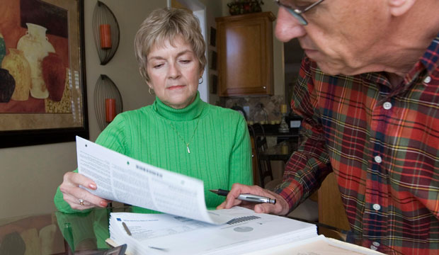 A couple review their financial statements, October 2008.