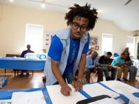 AmeriCorps volunteer helps at a job fair