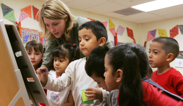 A preschool teacher works with students at the Shiloh School in downtown Waukegan, Illinois, April 2006.
