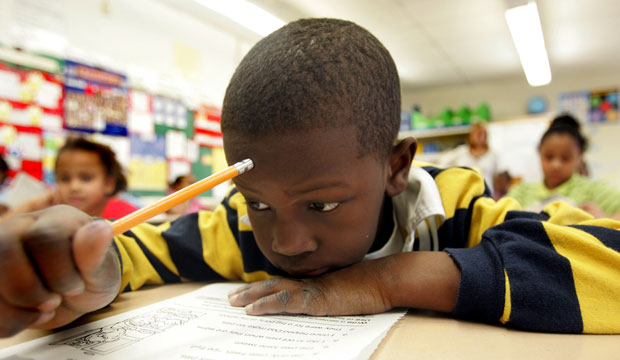 A second-grade student reads a book during a literacy class at the John Fenwick Elementary School in Salem, New Jersey, February 2006.