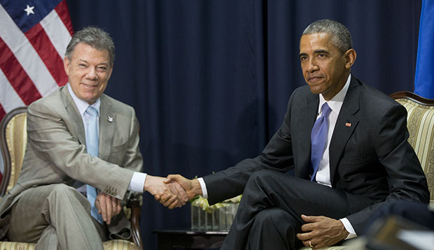 U.S. President Barack Obama, right, shakes hands with Colombian President Juan Manuel Santos, left, during their bilateral meeting at the Summit of the Americas in Panama City, Panama, April 11, 2015.