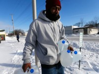 A Flint resident carries free water