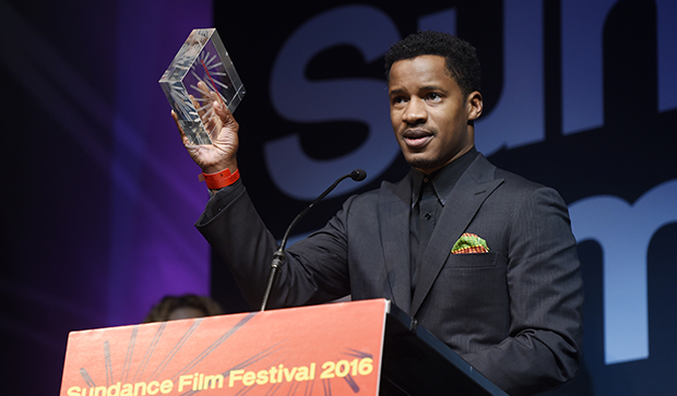 "Nate Parker, director, star, and producer of ""The Birth of a Nation,"" accept the U.S. Dramatic Audience Award for the film during the 2016 Sundance Film Festival Awards Ceremony, January 30, 2016, in Park City, Utah."