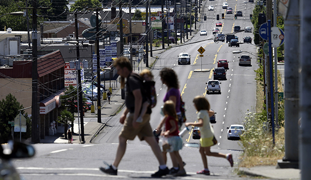 Pedestrians cross the wide swath of 82nd Avenue in East Portland, Oregon, July 2015.