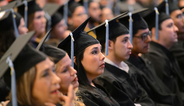 Graduating students listen to a commencement address in May 2015.