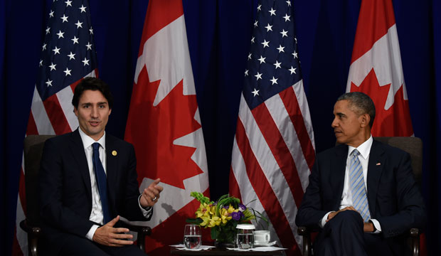 President Barack Obama, right, listens as Canada's Prime Minister Justin Trudeau, left, speaks at the Asia-Pacific Economic Cooperation summit in Manila, Philippines, November 19, 2015.