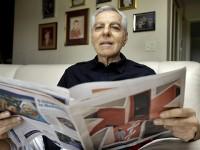 Man reading Medicare brochure