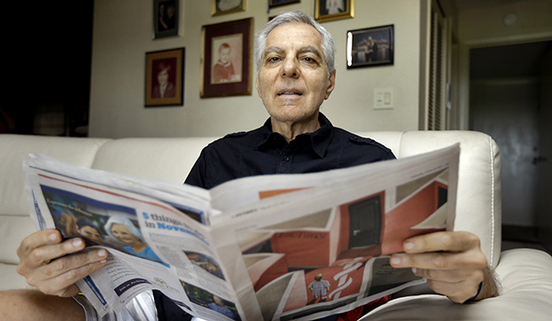A man looks over a Medicare brochure at his home in Seminole, Florida, November 2015.