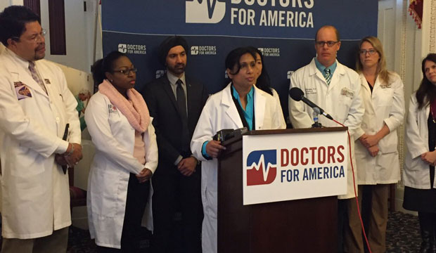 Doctors for America presents a petition at a press conference on December 2, 2015, in Washington, D.C.