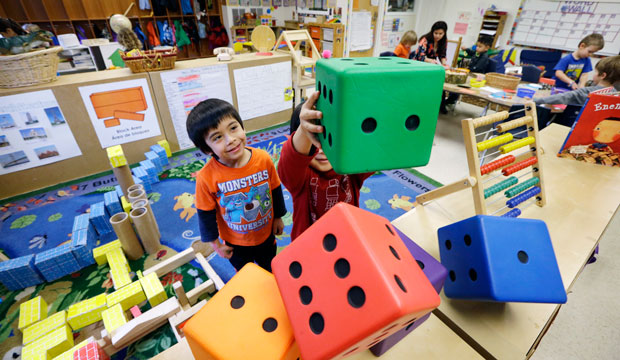 Children play at the Creative Kids Learning Center, a school that focuses on pre-kindergarten for 4- and 5-year-olds, in Seattle, Washington, on February 12, 2016.
