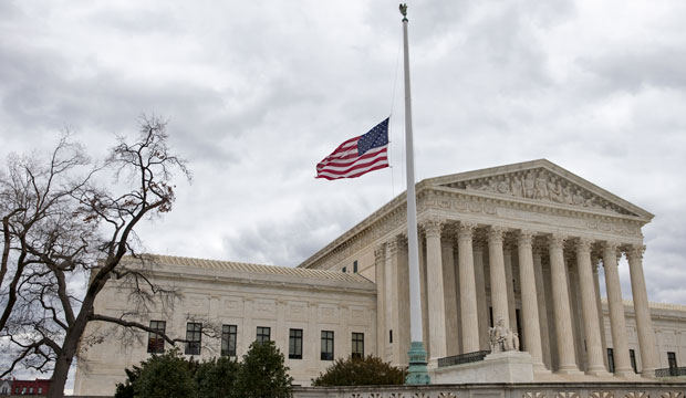 A flag on the Supreme Court building's front plaza flies at half-staff on February 25, 2016, in honor of Justice Antonin Scalia.