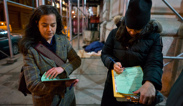 Alexis Sypek, left, and Victoria Parker conduct a survey of homeless people on the streets of New York City on February 9, 2016.