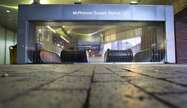 Gates are closed at the McPherson Square Metrorail Station in Washington, March 16, 2016.