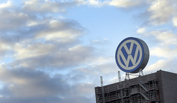 Giant logo of the German car manufacturer Volkswagen on top of factory