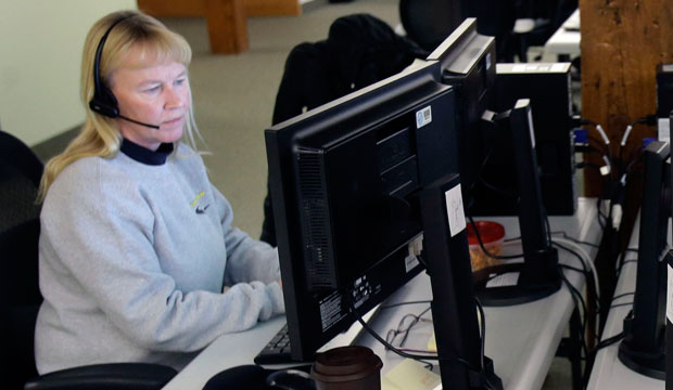 A worker makes calls at a phone bank in St. Paul, Minnesota, on December 31, 2013.
