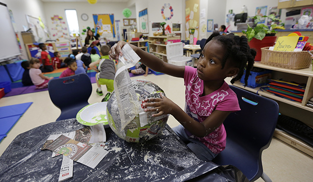 A pre-K student does paper-mache at the South Education Center in San Antonio, April 2014.