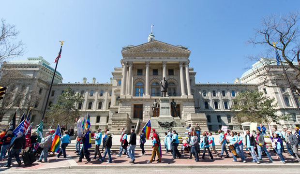 Opponents of Indiana's Religious Freedom Restoration Act march in protest past the Indiana Statehouse on April 4, 2015.