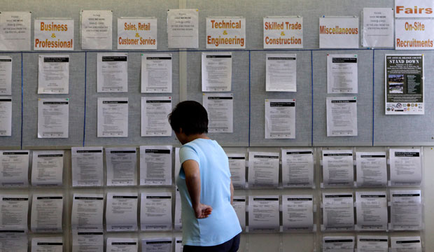 A woman looks at listings on a bulletin board in Westminster, California, on September 8, 2011.