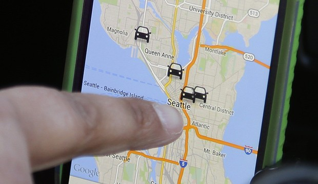 A driver for the ridesharing service Lyft uses Lyft's smartphone app.