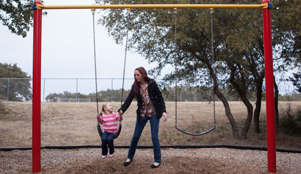 A woman plays with her 3-year-old daughter in Lakeway, Texas, in January 2014.