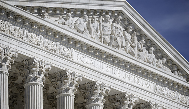 The columns and west pediment of the U.S. Supreme Court building are seen in Washington, April 12, 2016.