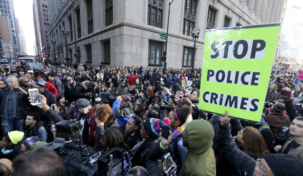 Chicago protesters call for Mayor Rahm Emanuel and Cook County State's Attorney Anita Alvarez to resign on December 9, 2015.