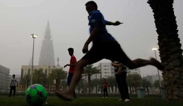 Saudi youth play soccer.