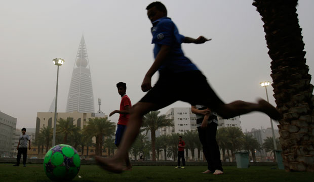 Saudi youth play soccer in a park during a dust storm in Riyadh, Saudi Arabia, on April 25, 2015.