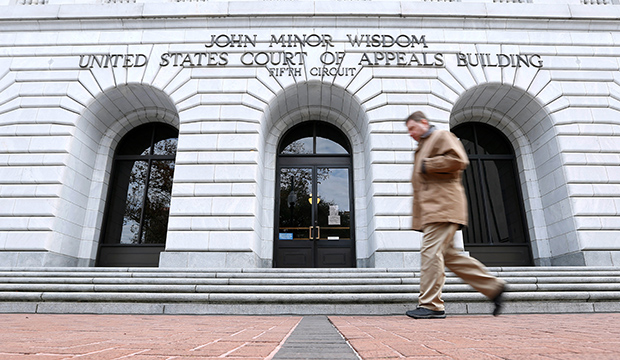 A man walks in front of the U.S. Court of Appeals for the 5th Circuit, January 7, 2015.