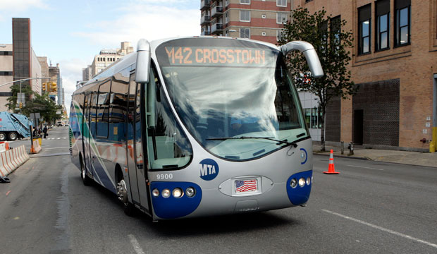 New York City's Metropolitan Transit Authority tests a new 35-foot-long electric hybrid bus, which runs along 42nd Street in New York City, on October 12, 2007.