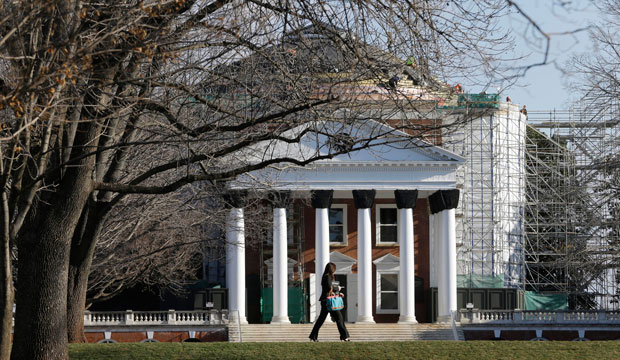 A student walks across the lawn in front of the Rotunda at the University of Virginia in Charlottesville, Virginia, on February 20, 2013.