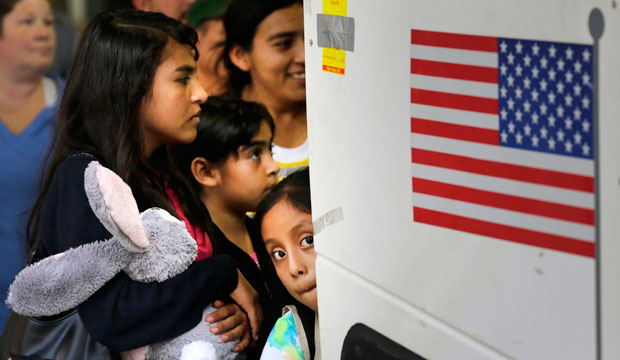 Children from El Salvador and Guatemala board a bus after being released from a family detention center in Texas on July 7, 2015.