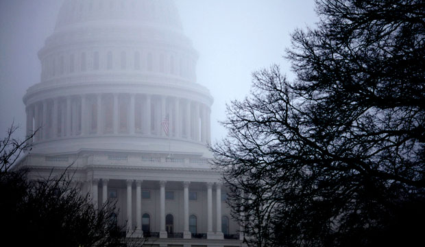 Fog obscures the Capitol dome in Washington, D.C., on December 10, 2012.