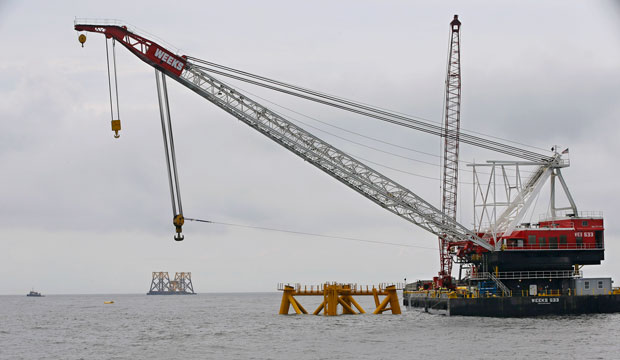 The first wind turbine foundation jacket for the Block Island Wind Farm—the United States' first commercial offshore wind facility—is seen offshore of Rhode Island in July 2015.