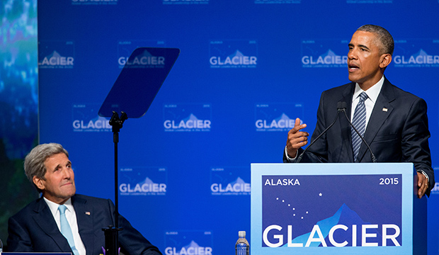 President Barack Obama, right, accompanied by Secretary of State John Kerry, left, speaks at the Global Leadership in the Arctic: Cooperation, Innovation, Engagement, and Resilience, or GLACIER, Conference in Anchorage, Alaska, August 31, 2015, attended by Nordic foreign ministers, native leaders, and dignitaries from 20 countries. President Obama opened a three-day trip to Alaska, where he witnessed and warned of a warming world and issued an urgent call to action on climate change.