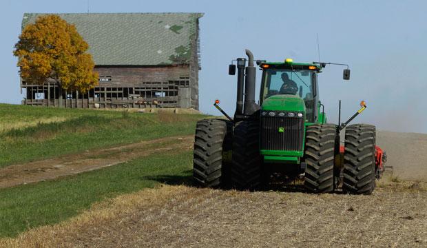A central Illinois farmer cultivates his cornfield in Illinois, October 2012.