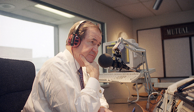 Pat Buchanan listens to a caller during his radio show in Washington, February 16, 1995.