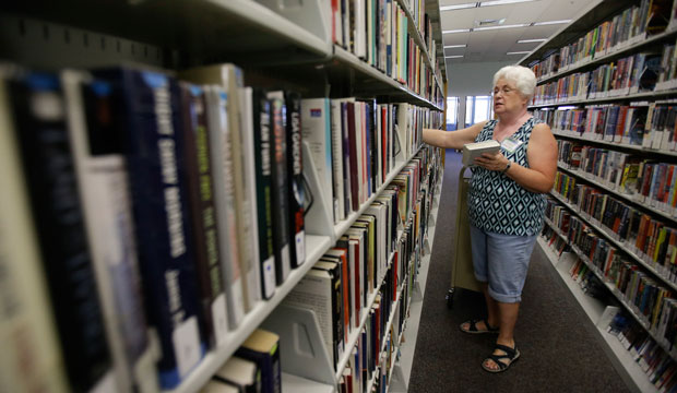 Shonna Bennett volunteers at a branch of the Citrus County Library in Beverly Hills, Florida, on September 10, 2014.