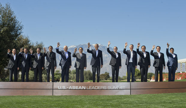 President Barack Obama, center, and leaders of ASEAN wave as they pose for a group photo at the Annenberg Retreat at Sunnylands in Rancho Mirage, California, on February 16, 2016.