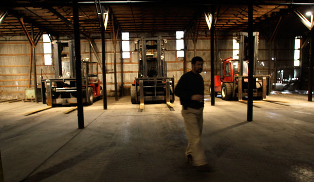 Brantley Price walks past idle forklifts at a closed plant in West Jefferson, North Carolina, on December 18, 2008.