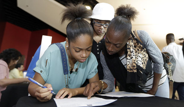 Lashrundra Wilfork, right, helps her daughter Nala fill out a job application in Sunrise, Florida, on June 10, 2015.