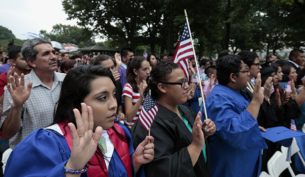 "DREAMers and parents take an oath in a mock citizenship ceremony during a ""United We Dream"" rally on Capitol Hill in Washington, D.C., July 2013."