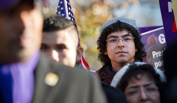 A young man from Colombia who is qualified for the DACA program attends a rally in front of the White House on November 21, 2014.