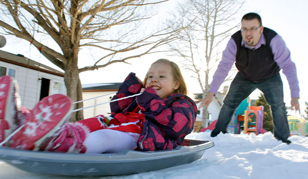 Coy Mathis is pushed on a sled by her father at their home in Fountain, Colorado, in February 2013.